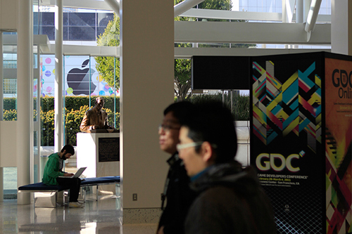 Apple's logo stares unblinkingly through the windows of the GDC
