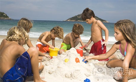 kids building sandcastle(from guardian.co.uk)